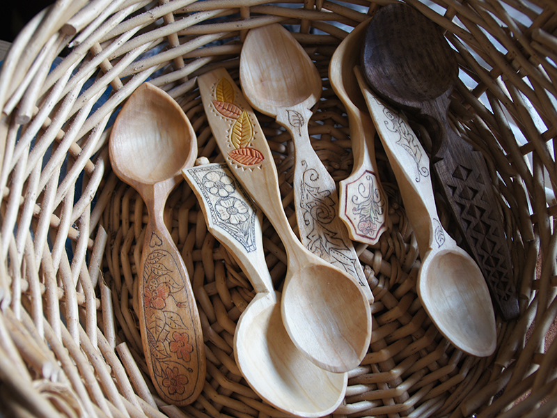 Basket of fresh-carved spoons.
