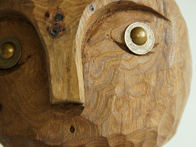 Detail, Wooden Figurative Sculpture of Elm and birch. With old subway tokens for eyes.