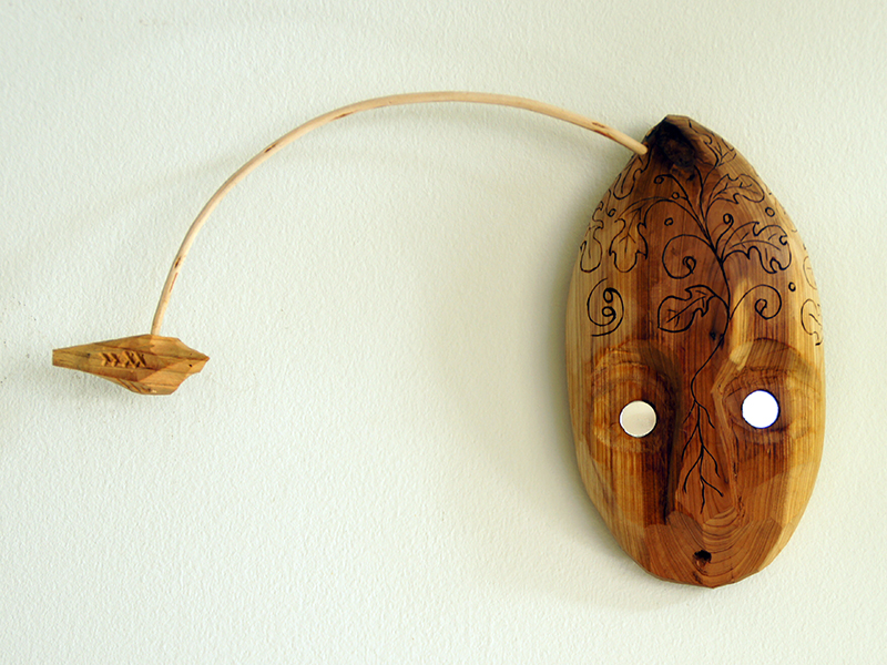 Whisper. Wooden mask and bird telling stories. Dyslexia series.