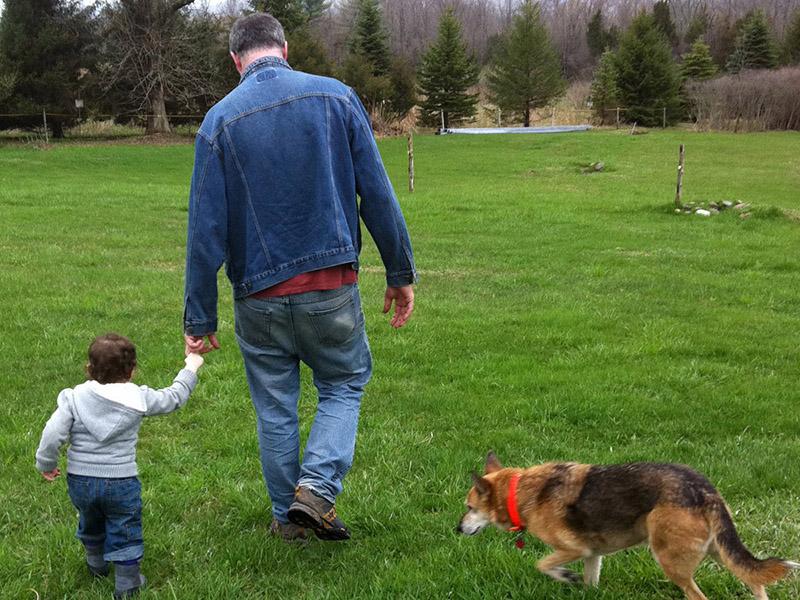 Steve, baby Mariska and Kali Dog walking away